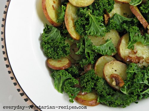 kale, potato and walnut salad in a bowl